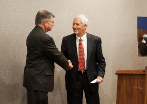 Metro Nashville Public Schools' Director Dr. Jesse Register thanks Belmont President Bob Fisher for the Bridges program.