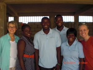Taylor and Robin smile with LiveBeyond's maternal health clinic workers.